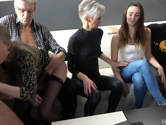 Wild group sex on the bed with a couple of mature amateurs