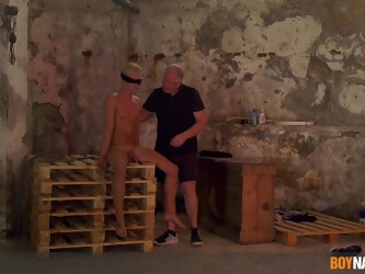Nasty BDSM video of a mature pervert poking and torturing a stud