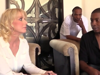 Insatiable blonde housewife, Cammille Austin likes to get down and dirty with three horny black guys