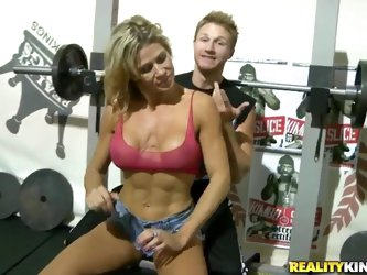 Young buddy finds an amiable sexy MILF training in the same gym with him and asks her to spot for him with barbell. Then man makes friends with her an