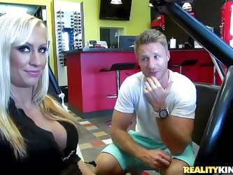 Zoey Portland is a sexy milf in need of car repairs. she heads to the garage to see a hunk of a mechanic and they start fucking hard. He rubs her tits