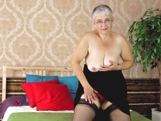 Don't be surprised! Old women wants to feel sexy every now and then too! Granny wears stockings and daring underwear while she feels herself in b