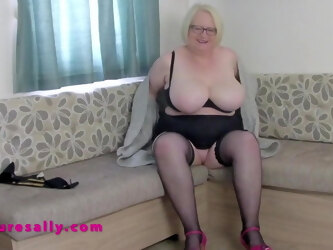 Very busty British mature Sally in stockings and heels