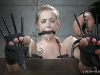 Watch as this unlucky slave is wrapped up tightly with cloth around her feet. She has clamps and chains attached to her nipples, and when the master p