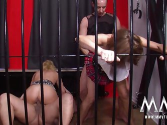 Two couples get into some hard fucking in the swingers cage.