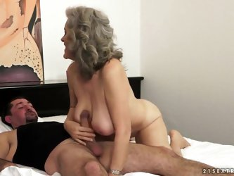 Awesome old granny Aliz is being nicely drilled in her asshole by the younger guy, that sure likes fucking this kind of babes. Enjoy the hot video of