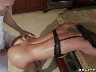 This babe with big tits and hot body is fucking real nice in kitchen while her husband is out of town. This guy fucks her from behind holding her tigh