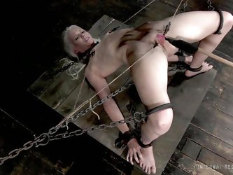 Sarah Jane Ceylon is a sexy blonde milf who is in a lot of pain. She's tied up in the dungeon with rope and has her pussy prodded. Her vagina lip