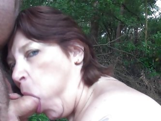 A walk in the nature end up with her sucking my cock, this chubby mature went down on her knees and grabbed my dick rubbing it with pleasure before wr