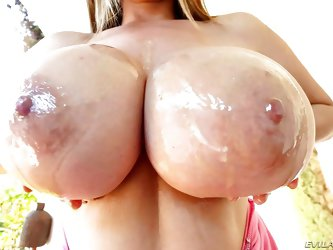 Kianna Dior is such a busty tease. She has her massive tits hanging out and she is going to make them look even better, by rubbing butter all over tho