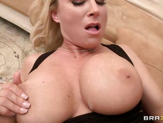 This blonde mommy is rubbing guy's dick against her big boobs and she loves to take his cock in her mouth. Meanwhile, guy is pressing her boobs a