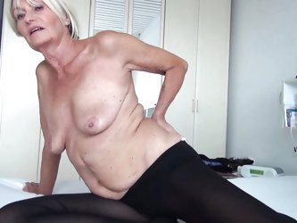 With short hair, fragile body and small tits this mature blonde still keeps some time for masturbation in her routine. She undresses and makes those w