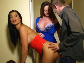 Chesty MILF who is wife of old man catches stepson fooling around with her black-haired girlfriend and decides to join them. Guy has massive cock and