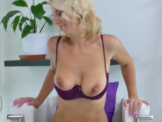 Horny blonde Luci Angel opens her legs to masturbate on the chair
